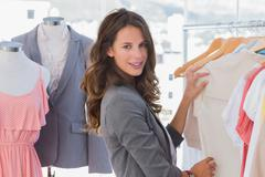 Stock Photo of Fashion woman choosing clothes