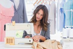 Stock Photo of Fashion designer sewing