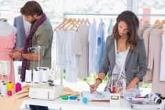 Fashion designers working - stock photo