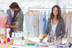 Stock Photo of Young fashion designers working