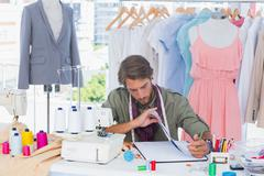 Stock Photo of Fashion designer sitting behind a desk
