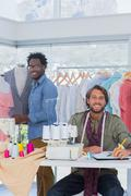 Fashion designers working in a creative office - stock photo