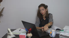 Young businesswonan working on laptop in her office.Close-up. Stock Footage