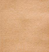Pattern of woolen knitted fabric Stock Photos