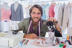 Fashion designer petting his chihuahua Stock Photos