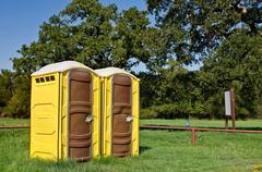 Yellow portable toilets Stock Photos