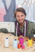 Fashion designer using sewing machine - stock photo