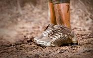Stock Photo of Mud race runner's shoes