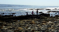 Kids On Rocky Shore Watch Ocean Surf Come In- San Pedro CA Stock Footage