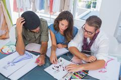 Three fashion designers working together Stock Photos