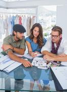Three fashion designers during a brainstorming Stock Photos