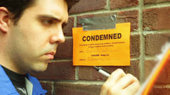 Condemned sign inspector inspection notes Stock Footage