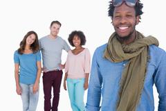 Fashion man standing in front of others young people - stock photo