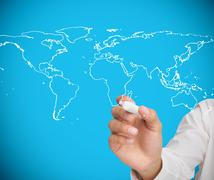 Businessman drawing world map Stock Photos