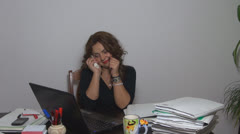 Young woman happy in his office talking on the phone Stock Footage