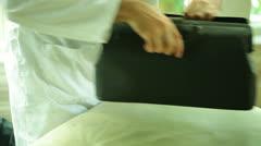 Doctor bag house call housecall Stock Footage