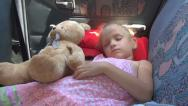 Stock Video Footage of Child Sleeping in Car, Sleepy Girl and Teddy Bear in a Driving Vehicle, Children