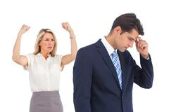 Anxious businessman and cheering businesswoman Stock Photos