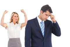 Winning businesswoman her anxious coworker - stock photo