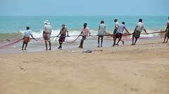Hikkaduwa, sri lanka - apr 26: local fishermen pull net from the ocean on apr Stock Footage