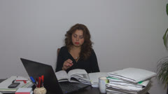 The young woman, tired, exhausted, in his office Stock Footage