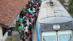 Bentota, sri lanka - may 02: passengers board the train on the station on may Stock Footage