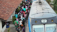 Stock Video Footage of bentota, sri lanka - may 02: passengers board the train on the station on may