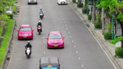 Bangkok - apr 12: cars, tuk tuk and taxis drive in a flow of megalopolis traf Stock Footage