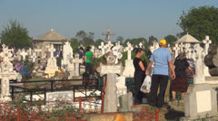 Widows with Candles at Orthodox Cemetery, Cross, People at Graveyard Stock Footage