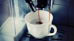 Coffee machine pouring cappuccino in cup Stock Footage