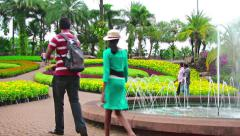 People walks in famous Nong Nooch tropical garden Stock Footage