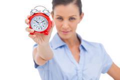 Stock Photo of Businesswoman holding alarm clock