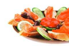 Olives salmon and pepper Stock Photos