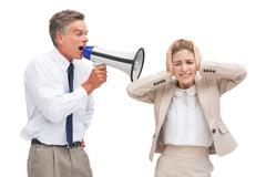 Stock Photo of Businessman yelling at his coworker with megaphone