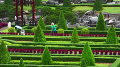 Street cleaner in Nong Nooch tropical garden in Thailand Stock Footage