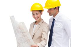 Architect team looking at construction plan - stock photo