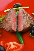 Stock Photo of meat savory : grilled beef fillet mignon on red plate
