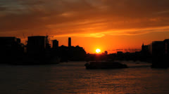 A tourist vessel sails through the Thames River with London skyline 3 Stock Footage