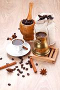 Black turkish coffee served with accesories on wooden table Stock Photos