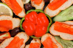 Pink salmon on baguette Stock Photos