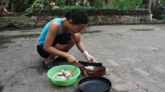 rural woman cuts boiled pork Stock Footage