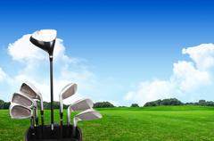 A set up new golf clubs on a beautiful golf course Stock Photos