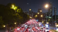 Traffic in the city. Avenue Time-Lapse, Night - Moon going down. Footage