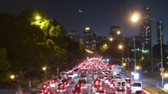 Traffic in the city. Avenue Time-Lapse, Night - Moon going down. Stock Footage