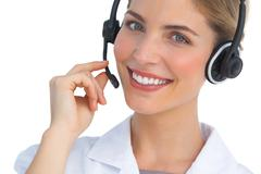 Stock Photo of Happy nurse working with headset