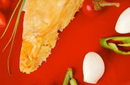 Stock Photo of cheese casserole piece on red plate