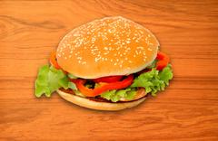 Fresh cheeseburger on wood background Stock Photos