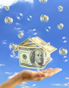real-estate bubble on the background sky - stock photo
