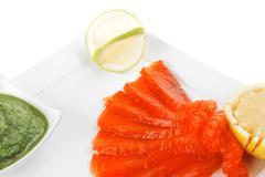 Smoked salmon with lemon Stock Photos