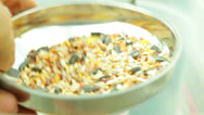 Stock Video Footage of measuring grain bird seed measure funnel 2